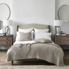 DREAM HOME | We do love to add a little symmetry to the home. Shop our 'Chiltern Thin Metal Oval Mirror' and 'Ardleigh Wide 2 Drawer Bedside Table' from the bio. #TheWhiteCompany #DreamHome #Interiors #DreamBedroom