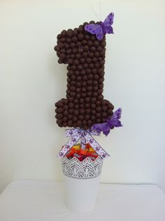 "Perfect for a 1st birthday. Malteser ""number 1"" lolly tree, with hootabelle ribbon."