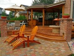 Lounge your days away with this deck and paver patio combination.