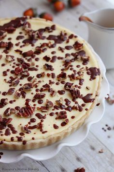 Silky cheesecake featuring two layers of chopped pecans and chocolate chips will make everyone rave about this recipe!