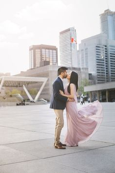 The setting sun lighting up Nathan Phillips square is the perfect place to get a truly Toronto engagement photo. Engagement Session, Engagement Photos, Toronto City, Toronto Wedding Photographer, Perfect Place, Wedding Photos, The Past, Sun, Lifestyle