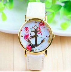 White Anchor Watch White banded watch with white floral print face & gold anchor. Boutique Accessories Watches