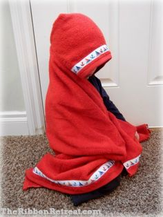 Hooded Towel Tutorial- I wish I knew how to sew!! This was an awesome gift from a coworker!! Aiden outgrew all of his baby hooded towels so quickly but this is perfect!! He'll be able to use it for a long time!