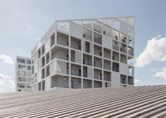French social housing project with a patchwork facade of solids and voids.