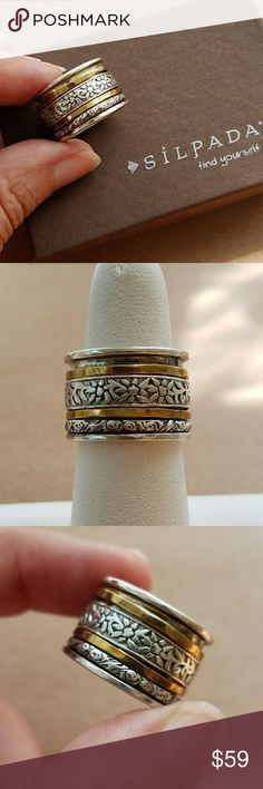 "Silpada Sterling Silver & Brass Spinner Ring This one's a Silpada classic!  Alternating bands of hammered brass and detailed sterling silver ""spin"" around a solid .925 sterling silver band.  To be comfortable, this wider band should be ordered in a slightly larger size than what you would normally wear.  It's technically a Size 8, however it ""fits"" more like a Size 7..5 so that's how I've listed it.  This ring is like new, from my sample line and includes a gift box. Silpada Jewelry Rings"