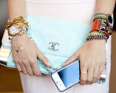 Dear lord. I love it all. Chanel clutch. Bangles galore.