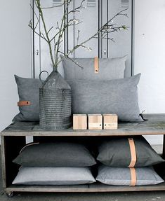 Good use of props to sell pillows. Create a scene with props that shows shoppers how to use the item or how it will look in use. Nice idea for photo styling selling pillows.