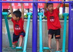 Children on the playground. Photo by Rick Miyajima. 2006.