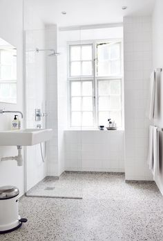 awesome white bathroom with terrazzo floor…