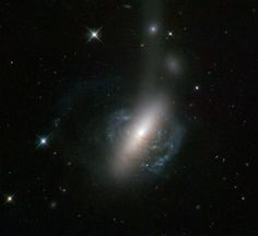This  new image from the NASA/ESA Hubble Space Telescope captures an  ongoing cosmic collision between two galaxies.