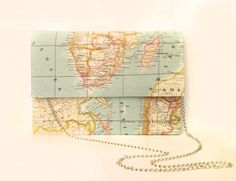 map clutch. Top Shop has map wallets too. I came up with an idea of designing map wallets in my ad graph class last semester. I was on top of things :P