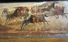 A Roman Chariot Race from Pompeii | Roman wall painting depicting a chariot race. From Pompeii: Casa delle Quadrighe (House of the four-horse chariots, or House of the Chariot Race). Now in the Naples Museum Dated by the museum: ca. 68-79 CE.