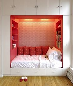 built in bed niche with bookcases and drawers.  Eden's fav.