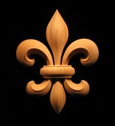 """An onlay featuring a beautiful classic Fleur de Lis. We can customize  4"""" T X 3 1/4"""" W--Paint grade --Maybe glue and paint on ea end of mantel front"""