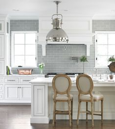 White Glazed Cabinets, Gray Backsplash and French Chairs
