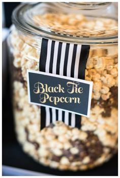 A Suit & Tie first birthday Party sweets display. Chocolate & Vanilla Popcorn to match the theme for bow ties and the stylish attire!