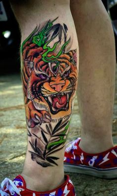 Neo traditional Tiger tattoo by Russ Bagwell at Royal Ave Tattoo and Fine Jewelry CO - Tattoos