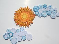 Unique wall decorations made from hundreds of strips of acid free carton paper rolled and glued together using quilling techniques. The