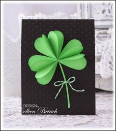handmade St. Patrick's Day card by Dietrich Designs ... luv the dramatic look of bright green on black .. lots of texture with embossing plate dots and folded shamrock petals ... photo tutorial on the blog ...