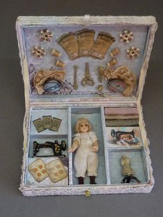Antique style style doll in a box with sewing accessories by Diane Yunnie