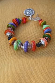 Bracelet by Earth & Sky Studio.  colorful and festive beauty! Would be even better as a necklace.