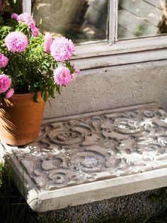 cement + a decorative door mat+crafty boots = a new front step