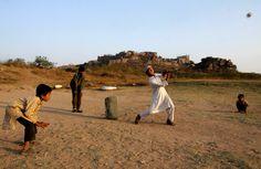 Indian children play cricket near the Golconda Fort in Hyderabad, India February (Mahesh Kumar A.
