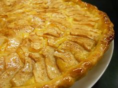 ~Tarte de Maçã, or Portuguese Apple Tart, is a signature of Portuguese dessert making. It combines fresh apples with a flaky crust and a slightly citrus lemon twist, to make a sweet and simple tart. This is a simple and quick dessert recipe for anytime that is perfect for serving with some ice cream and is always sure to impress~