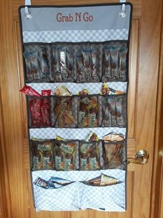 A wall of snacks is complete with the Thirty-one Hang Up Space Saver great for kid snacks.