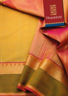 Be unusual and be bold. Pai Madi saree. Deep yellow ochre with Green border and temple motifs in zari. The pallu has a very simple graphic design complimenting the checks in the body.#Utppalakshi #Sareeoftheday#Silksaree#Kancheevaramsilksaree#Kanchipuramsilks #Ethinc#Indian #traditional #dress#wedding #silk #saree#craftsmanship #weaving#Chennai #boutique #vibrant#exquisit #pure #weddingsaree#sareedesign #colorful #elite