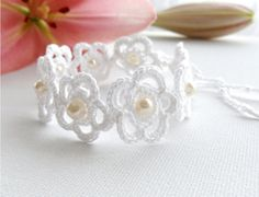 Level 18 - Can you make up a flower pattern like this one? If not, substitute one of the other flower patterns for this one, and stitch them together - Crochet Bracelet White Bracelet Daisy Bracelet by CraftsbySigita, Love Crochet, Crochet Flowers, Hand Crochet, Knit Crochet, Crochet Daisy, Crochet Crafts, Yarn Crafts, Crochet Projects, Daisy Bracelet