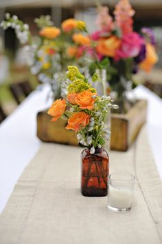 Maybe with orange ranunculus?   These eclectic centerpieces throw normal color palettes to the wind and use both pastel and bright blooms with lots of varieties and use apothecary jars, medicine bottles, trunks, books, and other thrifty Items to fill with flowers or just use on the table of the Wedding or event.
