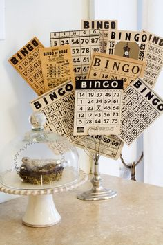 Nice vintage bingo card display using a photo holder.