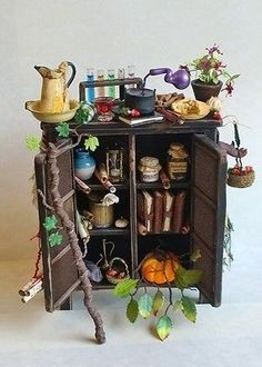 D house Miniature Handmade Rustic Witch Potion Cabinet 1 Scale Witch Wizard Halloween Miniatures, Fantasy Miniatures, Clay Miniatures, Dollhouse Miniatures, Fairy Furniture, Miniature Furniture, Dollhouse Furniture, Haunted Dollhouse, Haunted Dolls