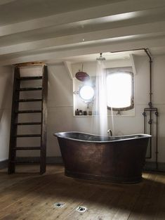 An old copper bathtub will add class and rustic look to any bathroom. Love these old tubs.