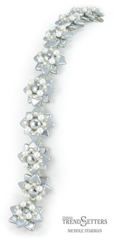 Silver Star by Nichole Starman makes a bracelet, earrings, or a ring. Free PDF pattern download