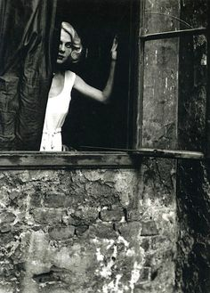 a captured moment in time   Woman at the Window, Vienna, 1933. Photo by Bill Brandt.