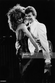 Singers David Bowie and Tina Turner perform on stage at the NEC Birmingham.
