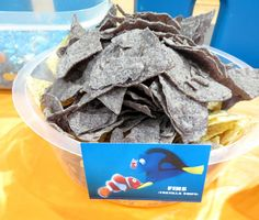 Finding Dory Party Food- Ocean Theme - Shark Fins- Tortilla Chips - served with spinach dip labeled Sea Weed Dip