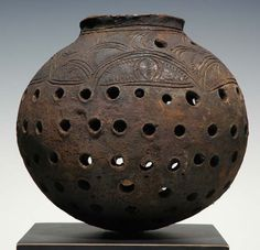 clay pot from the Keram River area of Papua New Guine. Such pots were used to store already smoked items relatively fresh above the cooking fires.