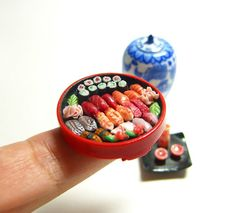 Miniature sushi and sake set, with attention to detail.