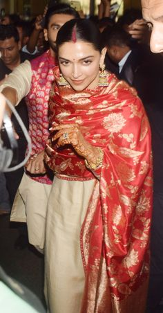 Deepika looked goregous as the new bride as she wore a cream suit paired with a silk red dupatta and heavy traditional jewellery Indian Attire, Indian Wear, Indian Outfits, Pakistani Wedding Outfits, Bridal Outfits, Saree Wedding, Velvet Dress Designs, Heavy Dupatta, Indian Designer Suits
