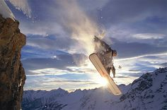 Image: Nothing but air! This snowboarder makes jumping off a rock look easy. (© Jakob Helbig/Getty Images)