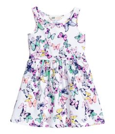Sleeveless dress in cotton jersey with a printed pattern, seam at waist, and gently flared skirt.
