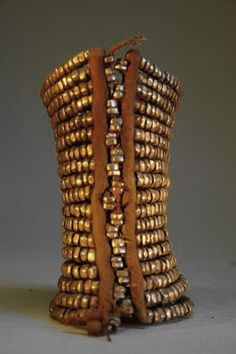 Married Himba women wore heavy anklets. They were made of hand wrought iron beads, then strung onto a leather support structure. Anklets such as these displayed wealth and were worn daily.