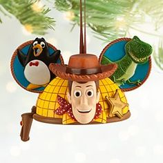 Disney Woody Ear Hat Ornament | Disney StoreWoody Ear Hat Ornament - Sheriff Woody can round up a posse of <i>Toy Story</i> ear hat ornaments to decorate your tree. Here he has the ear of Rex and Wheezy who join him on this detailed ornament designed by Disney artist Costa Alavezos.