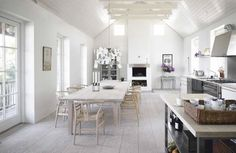 Wegman chairs, pale bleached floor, high ceilings, lots of white - am loving this inspiration for the perfect lofty summerhouse kitchen