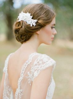 An idyllic country garden wedding calls for the Winslet ornate bridal lace comb, radiating its fine hand-beading with subtle pearl accents.