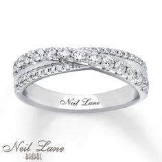 Ribbons of diamonds and smooth white gold intersect in this stunning anniversary band from Neil Lane Bridal®. The ring totals carat in diamond weight. Diamond Total Carat Weight may range from - carats. Anniversary Rings For Her, Diamond Anniversary Bands, Diamond Bands, Gold Bands, Diamond Wedding Bands, Vintage Anniversary Rings, 25th Anniversary, Unique Diamond Rings, Diamond Cluster Ring