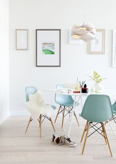 blue molded Eames chairs + mod white table